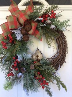 Christmas Wreath for Door-Winter Wreath-Birdhouse Wreath-Bird Lover Gift-Evergreen Wreath-Christmas Sleigh Bell Wreath-Christmas Berry Wreath  Ill admit, I have a real soft spot for birds. I love filling the feeders in the winter and watching all the action. This wreath speaks to the bird lover. A natural grapevine wreath is covered with a generous mix of realistic evergreen boughs. Snowy branches and pinecones add to the natural wintery feel. A sweet, little birdhouse made of birch bark…