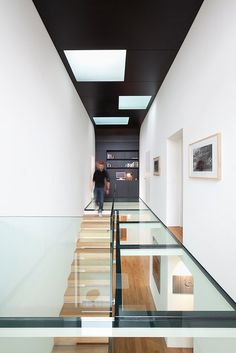 interesting space with black ceiling and wooden floor and stairs