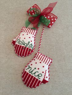 Naughty & Nice mitten ornament ~ canvas by Kathy Schenkel