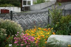 knitted fence by Anne Eunson, a resident of Hamnavoe, in Shetland; made from black fishing net twine