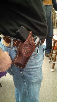 A new Holster design.....called a Paddle Holster! No need for a belt, the 'paddle' portion slips inside the jeans with the holster on the outside.... see our facebook page for more pics!   shasta leatherworks