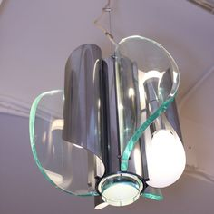 Chandelier in chrome with 3 curved glass panels and glass disk below one adjustable cable wire made in Milan 1960s.