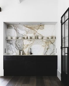 Impressive marble backsplash in the kitchen designed by Handelsmann and Khaw