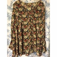 Show Me Your Mumu Perveen Pirate Tunic Show Me Your Mumu Perveen Pirate Tunic in Frankie's Garden. Size Small. This has been worn twice but it unfortunately has a small tear on the seam and a run on the sleeve. No trades please! Show Me Your MuMu Tops Tunics