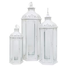 Crafted from metal and showcasing feminine cutout accents, this white-finished candle lantern set brings classic appeal to your entryway console table or liv...