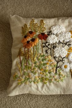 Crewel work... May have pinned this before... But I love how textile (is that the right word?) the pillow looks!