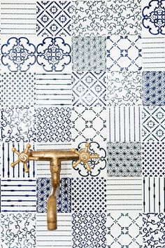 Turkish tiles (same colour pallatte, different patters) and gold tap