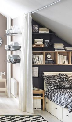 The black and white rug echoes the sheets and moody grey wall, making the space feel balanced and full.