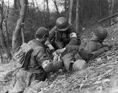 The Battle of the Bulge: Jan. 1, 1945. Victory for the allied forces came at a heavy price: Nearly 20,000 Americans were killed and tens of thousands more were wounded, missing, or captured. For American forces, the Bulge was the single bloodiest battle of World War II. Here, soldiers tend to the wounded in the Ardennes.