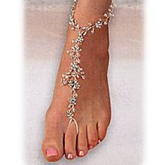 Pretty bridal footwear for vows in the sand!