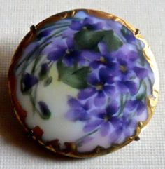 Very pretty hand painted porcelain pin.