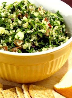 This recipe, which we are addicted to, may irk tabbouleh purists. In the Middle East, tabbouleh is invariably made by hand. The parsley is chopped painstakingly into mounds of light, tenderly sliced leaves - not bruised by rough blades or food processors. It's a laborious and special dish.