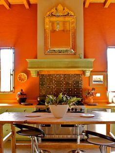 The cultural aspects of a Spanish-inspired home interior make it a popular choice among Americans. Whether you love a Southwestern or Old World Spanish look, these design ideas will help you incorporate Spanish-style flair into your home. Spanish Style Decor, Spanish Design, Mexican Style Homes, Wooden Beams Ceiling, Kitchen Design, Kitchen Decor, Mexican Kitchens, Orange Kitchen, Entry Way Design