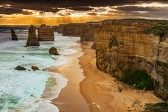 Another shot from the Famous 12 Apostles near Melbourne.Was a cloudy day and the sun came out for just a few minutes. The whitening along the hill edges is because of the intense wind and water and sunlight mix. It was sort of fog/mist.
