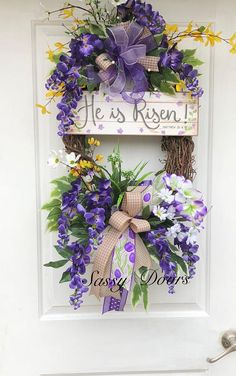 Bring a spring floral arrangement to your door with this stunning spring door wreath. This beautiful wreath is designed on a oval grapevine wreath. The focal point is what Easter is all about....and it is not the bunny . Adorned with stunning purple wisteria, forsythia, dogwood,