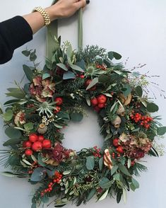 christmas wreaths Chalky grey greens with pops of red for lovely matildagoad Theres still time to order your Christmas wreath Order books close Decorations Christmas, Christmas Door Wreaths, Christmas Flowers, Christmas Mood, Noel Christmas, Rustic Christmas, All Things Christmas, Christmas Crafts, Holiday Decor