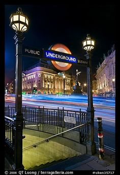 Underground entrance and lights from traffic at night, Piccadilly Circus, London