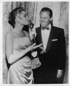 """Grace Kelly   Kissing Oscar  1955 Academy Award for Best Actress for her portrayal of Georgie Elgin opposite Bing Crosby in """"The Country Girl"""" (1954)"""