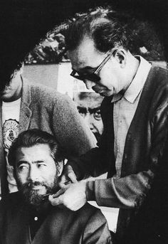 Director Akira Kurosawa shaving Toshiro Mifune's beard during the filming of Red Beard, 1965.