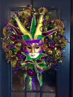 A personal favorite from my Etsy shop https://www.etsy.com/listing/218923120/mardi-gras-deluxe-mask-wreath