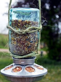 Bird Feeder.  All you need is a Mason jar, twine, and a small round chicken feeder, and the birds will be flocking to your yard before you kn...