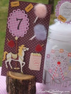 "#Carnival #Weddings -""Rustic Carnival Wedding"" -Carnival Table Number Holders with cotton candy filled mason jars with a ferris wheel on the front."