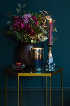 Love the mix of golds, brass, blue and purples in this scene. The gold hexagonal side table would look great at the end of a sofa, and the rich, deep colours are ideal for autumn and winter living rooms. Cant get enough of this new colour palette Winter Living Room, Home And Living, Estilo Interior, Interior Styling, Nordic Interior, Interior Modern, Decoration Hall, Deco Addict, Dark Interiors