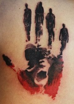 Abstract art hand tattoo on back