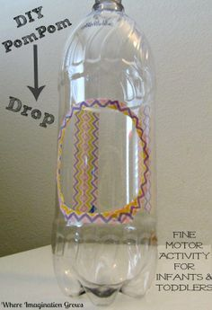Pompom drop fine motor activity for toddlers using a recycled bottle. Gloucestershire Resource Centre http://www.grcltd.org/scrapstore/