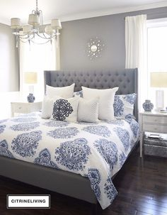 Bedroom furniture ideas - This room features a beautiful match of blue and white on the bed cover with a touch of blue offered by the vases for extra effect. www.homemagez.com