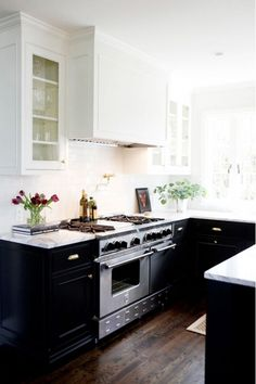 Kitchen with small black cupboards
