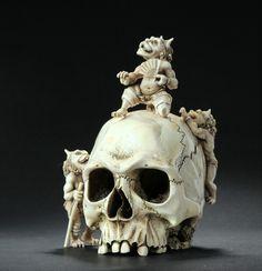 Carved ivory skull