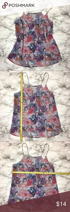 H&M flowy flowered two-tier tank top Super cute and light flowered spaghetti strap tank top from H&M. Love this top with ripped jeans and minimalistic sandals. Perfect for spring and summer! H&M Tops Tank Tops