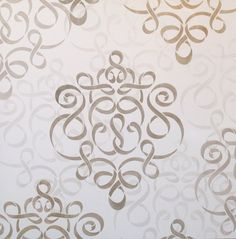 Large Ribbon Damask Wall Stencil! This was stenciled using 4 different colors of @Modern Masters Metallic Paints on a 3' x 3' sample board. On a real wall, I would space the motifs much farther apart. This stencil can be repeated randomly or in a formal pattern using the registration marks.