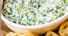 This crowd-pleasing party dip is a creamy blend of sour cream, cream cheese, spinach, and various cheeses and served with bread for dipping.