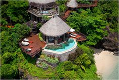 In Fiji lies the tiny private retreat that is Laucala Island. The exclusive luxury resort is set amidst 3,500 acres of stunning lagoons, powder-sand beaches, coconut plantations and mountains covered in lush greenery, it has only 25 villas creating an intimate desert isle feel. Each features a private outdoor shower, pool, and stylish, natural furnishings.