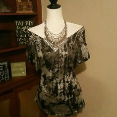 Rock & Republic Top Rock Republic Top   Beautiful Top   New without tag   Color :Black,silver,Grey   See the Beautiful Detail in the back it look great with some skinny jeans...  Match it with Gap Skinny  jeans available in my closet Rock & Republic Tops Blouses