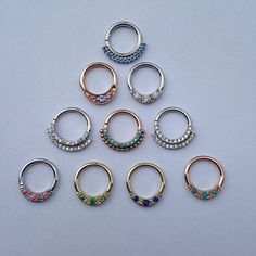 thecowpok: Our big, fancy septum ring order has arrived! White, yellow and rose gold with an array of sparkles and natural stones, there is something for everyone! Daith Piercing, Body Piercings, Piercing Tattoo, Septum Jewelry, Body Jewelry, Daith Earrings, Jewellery, Rose Gold Septum Ring, Jewelry Accessories