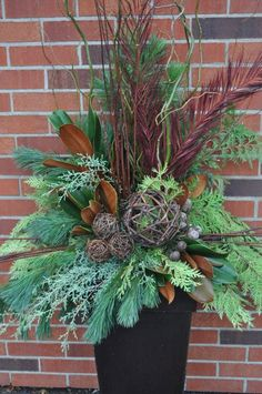 Image detail for -Countdown to Christmas! Well Fall first, but could make a transitional autumn into x mas holiday planter! Outdoor Christmas Planters, Christmas Urns, Christmas Greenery, Christmas Arrangements, Outdoor Christmas Decorations, Rustic Christmas, Winter Christmas, Flower Arrangements, Christmas Wreaths