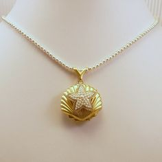 Vintage Starfish Adorned Clamshell Locket Pearl by heldhighdesigns