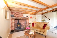 cosy beamed lounge area of a 4 star gold award winning barn conversion near Zennor