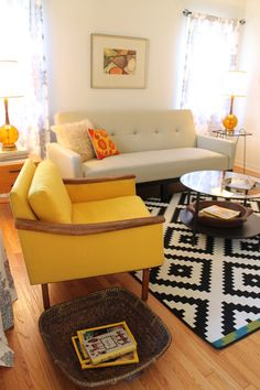 mid-century modern living rooms. Myriad Designs. All new furniture and furnishings, paint, and a glass mosaic fireplace surround transform this family room into ...