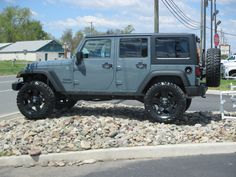 """Anvil Jeep Wrangler Unlimited Sport 4x4 with 35"""" tires on RockStar Rims"""