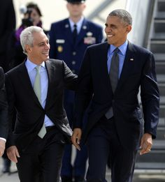 President Barack Obama right, talks with Chicago Mayor Rahm Emanuel left, after walking off Air Force One while arriving at O'Hare International Airport ...