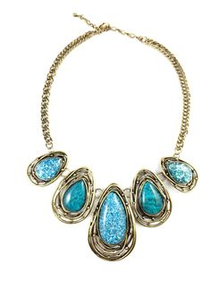 Marbled teal stones of varying lengths give this organic statement necklace a high end, sophisticated feel.  Lobster closure with 2