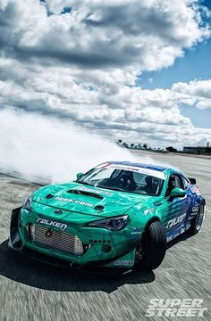 Image via We Heart It https://weheartit.com/entry/139358409 #blue #racecar #racing #smoke #track #turqoise #drifting