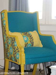 This chair was painted with fabric spray paint in teal.  The back of the chair had a coordinating fabric stapled on, and the trim was printed in yellow.  It's an amazing transformation.