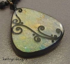Handmade curves swirls necklace colors of the ocean stained glass from Kathryn Designs