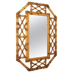 For Sale on - A handcrafted bamboo and rattan mirror with an interesting filigree work at the frame and Tiki or oriental accents, Spain, This piece is in excellent Bamboo Mirror, Wicker Mirror, Bamboo Canes, Bamboo Furniture, Geometric Decor, Faux Bamboo, Chinoiserie, Mid-century Modern, Antiques