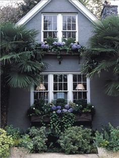 Maybe some window boxes on the front of the house.. ok, not unless they'll look like that!
